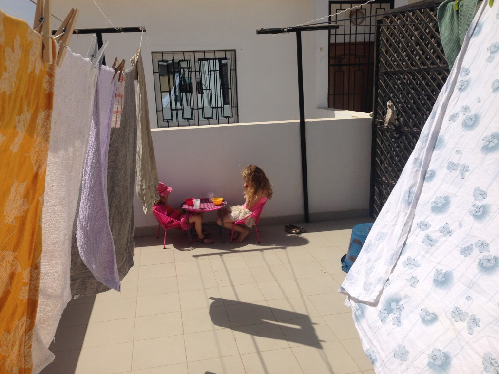 Doing laundry and enjoying the sun